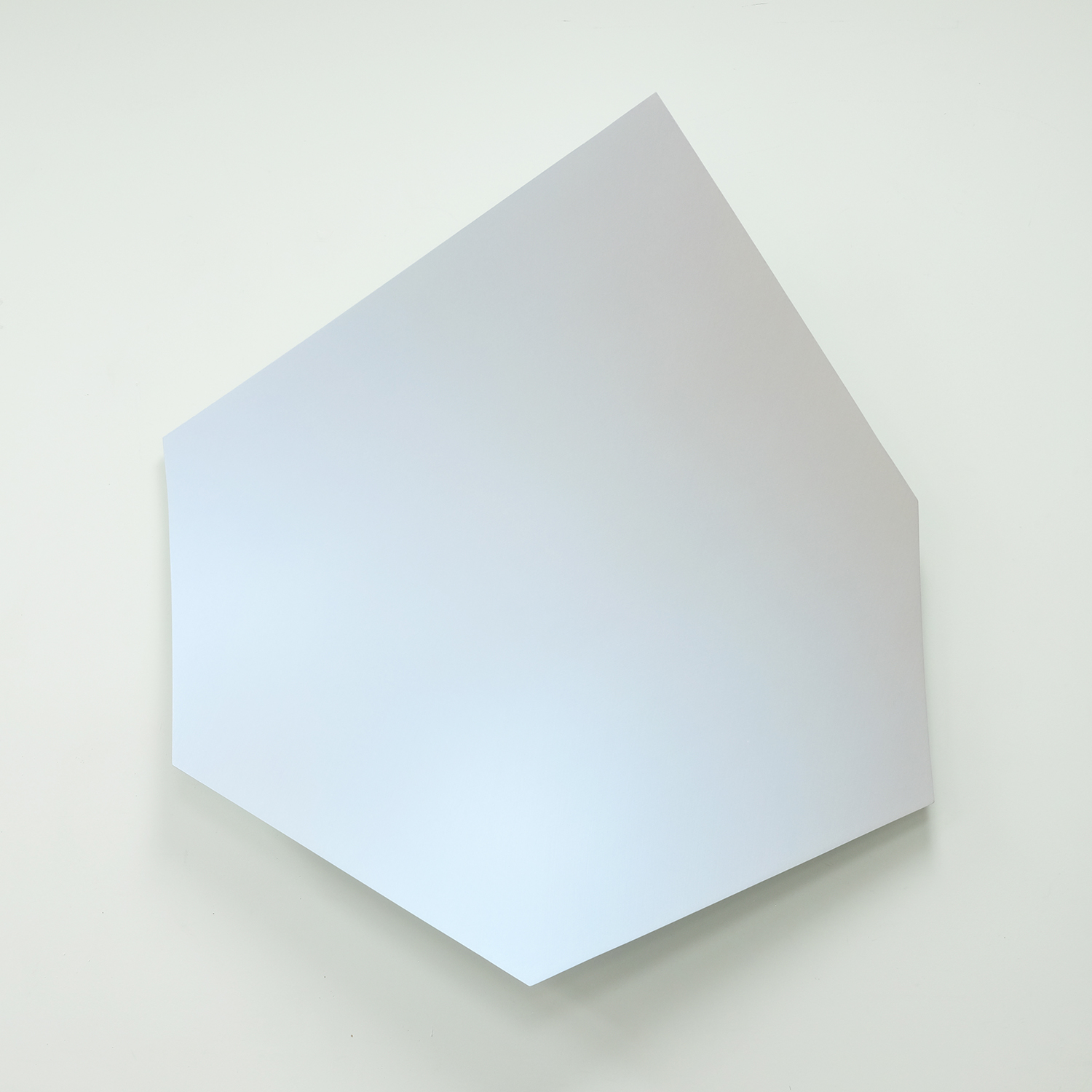 Artwork by Matthew Hawtin. Oblong hexagonal shape that is curved away from wall. Iridescent white surface.
